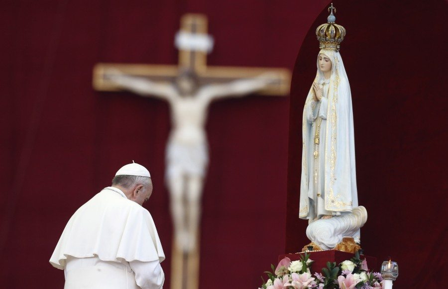 Pope Francis pays homage to the statue of St. Mary of Fatima at the end of the Marian prayer in St. Peter's square at the Vatican, Saturday, Oct. 12, 2013. (AP Photo/Riccardo De Luca)