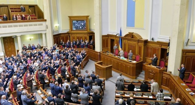 Deputies of the Ukrainian Parliament and members of the Government sing a national anthem after successfully voting for ratification of a Ukraine-EU association agreement in Ukrainian Parliament in Kiev on September 16, 2014. The Ukrainian and European parliaments on Tuesday simultaneously ratified a landmark pact at the heart of the ex-Soviet country's bloodiest crisis since independence. AFP PHOTO/GENYA SAVILOV        (Photo credit should read GENYA SAVILOV/AFP/Getty Images)