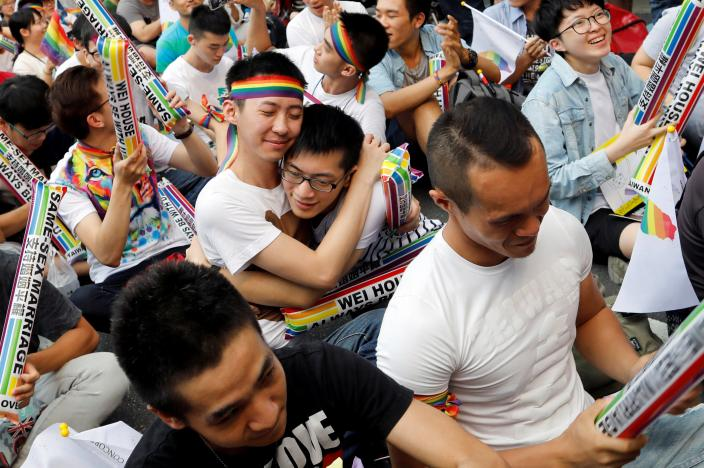 Supporters hug each other during a rally after Taiwan's constitutional court ruled that same-sex couples have the right to legally marry, the first such ruling in Asia, in Taipei, Taiwan May 24, 2017. REUTERS/Tyrone Siu