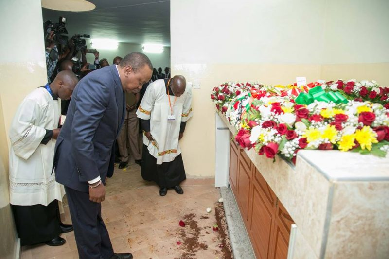 Uhuru Kenyatta bowing before the remains of Bishop Cornelius Korir